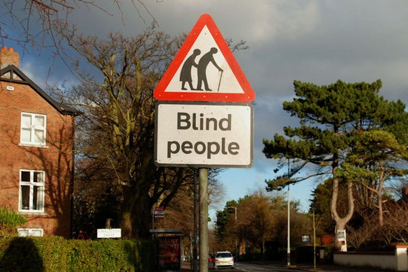 sign warns blind people are crossing the road
