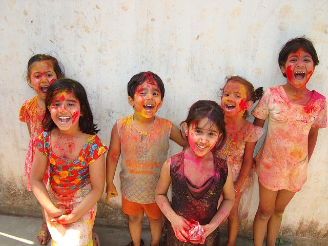 crowd of children wearing face paint
